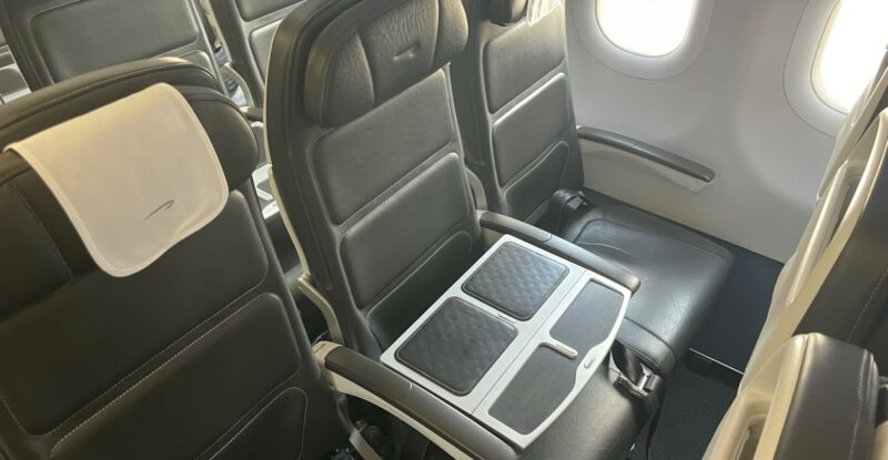 A seat triple aboard a BA narrowbody; this is the Club Europe section with the middle seat blocked by a table for placing one's drink or PED