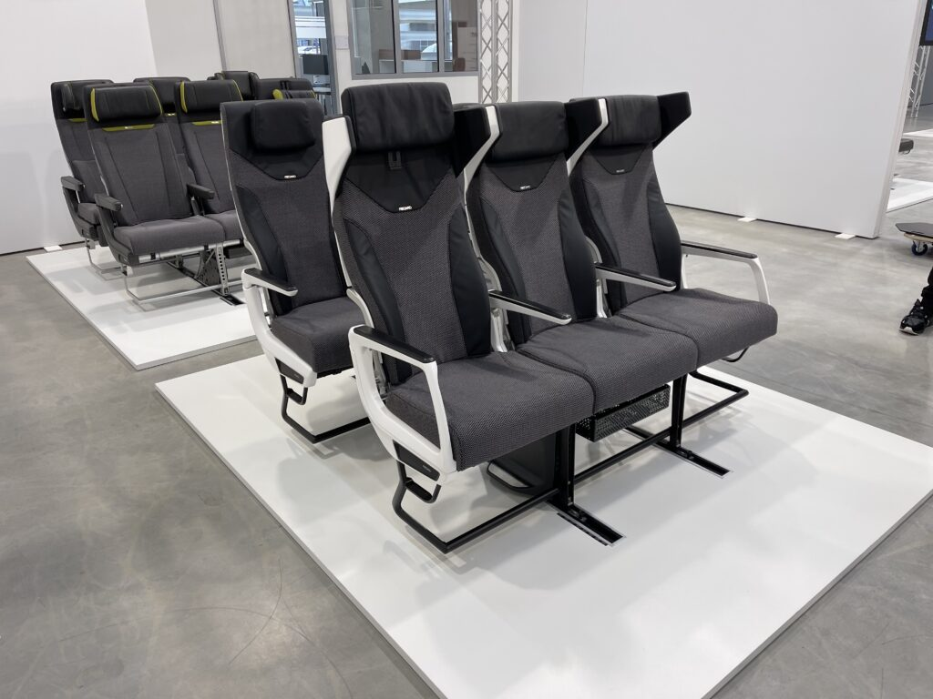Multiple seat triples of the CL3810 at the Recaro factory. In this image, one can see what the winged headrest looks like when fully deployed; it privates nice privacy