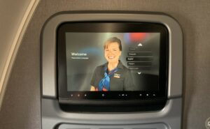 American Airlines A321 IFE welcome screen with a AA female flight crew displayed.