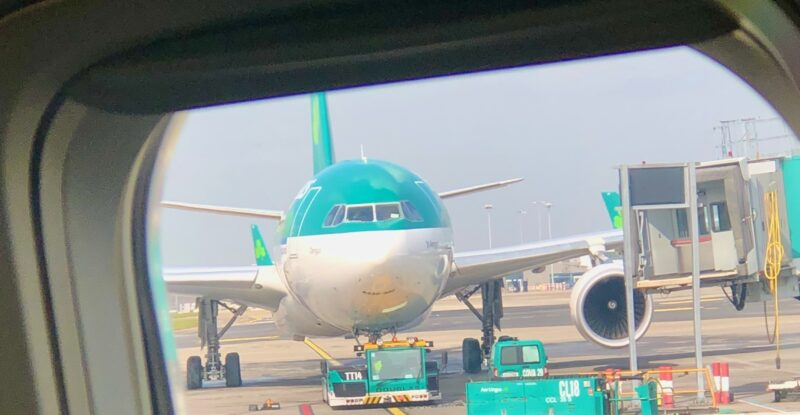 Parked Aer Lingus aircraft with the carrier's signature green and white livery
