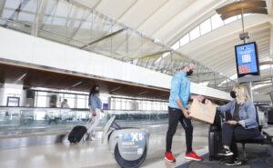 Robotic ambassador, NomNom, delivering food to LAX passengers.