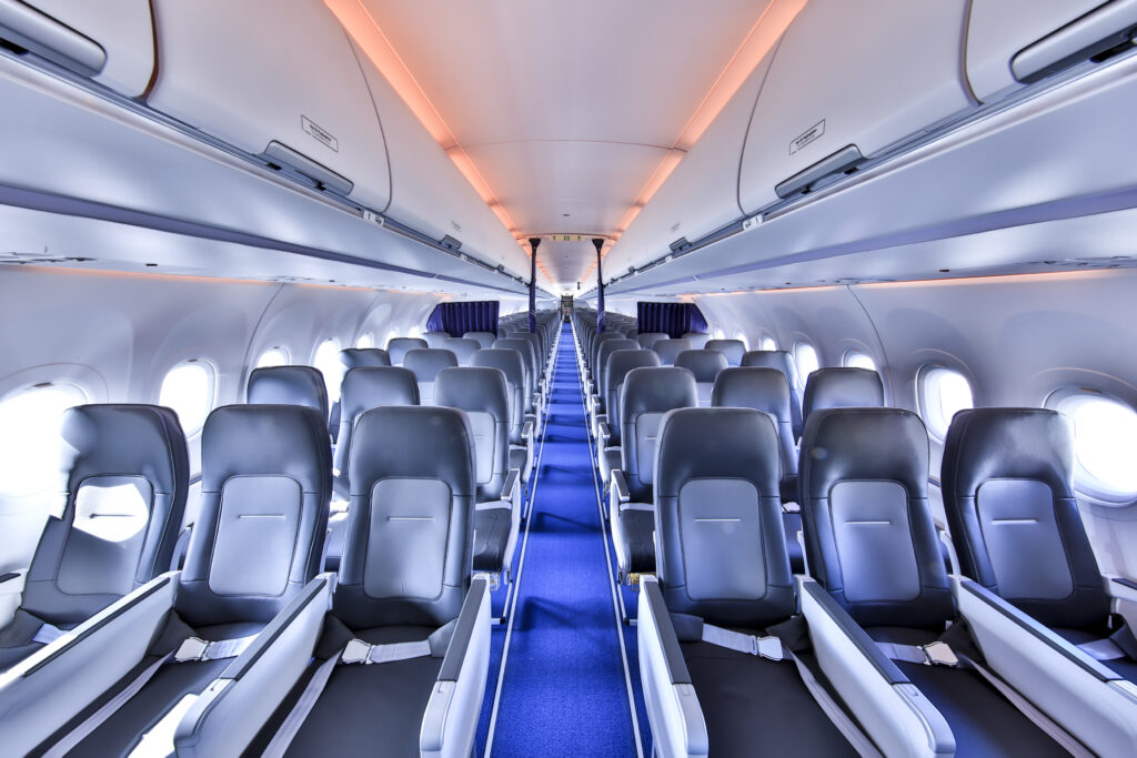 Interior shot of the Lufthansa A321neo aircraft with the burnt orange LED lighting.