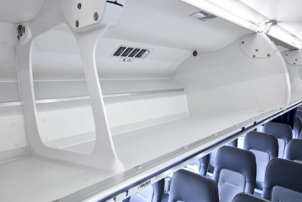 Close up shot of large open overhead bins.