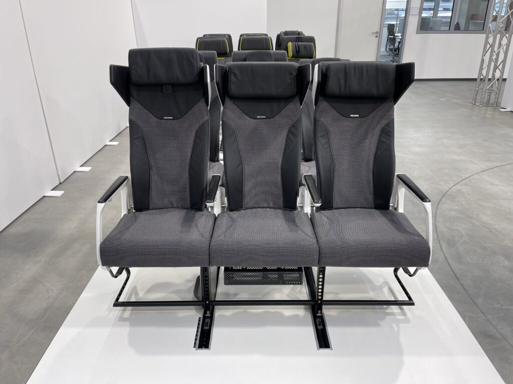 Direct front view of CL3810 at the Recaro facility. The seats are in shades of grey and in sets of 3.