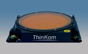 ThinKom displayed on a blue and grey background.