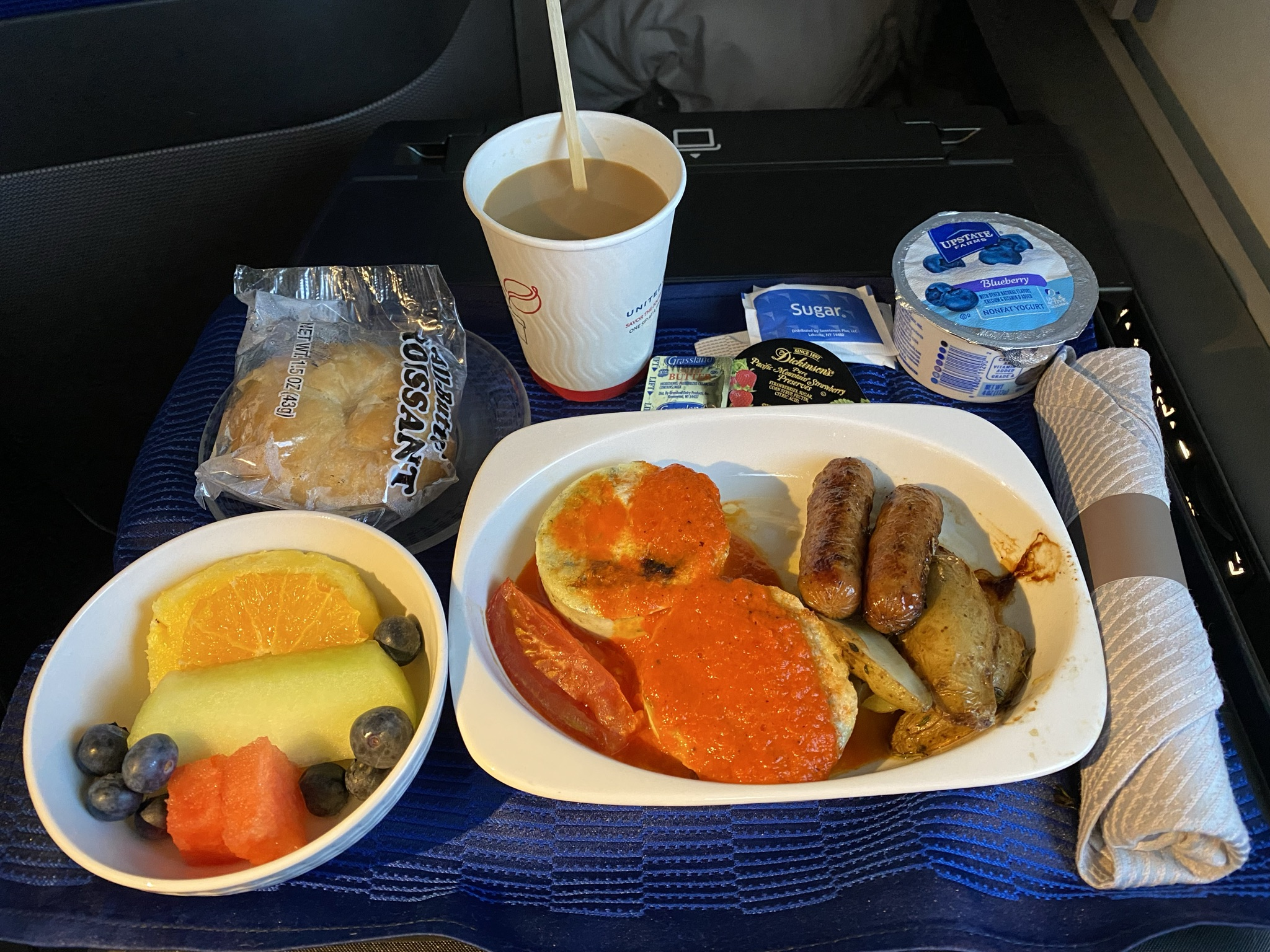 Breakfast in Business class on United's 767-300ER from JFK which consisted of fruit, sausage, eggs and coffee