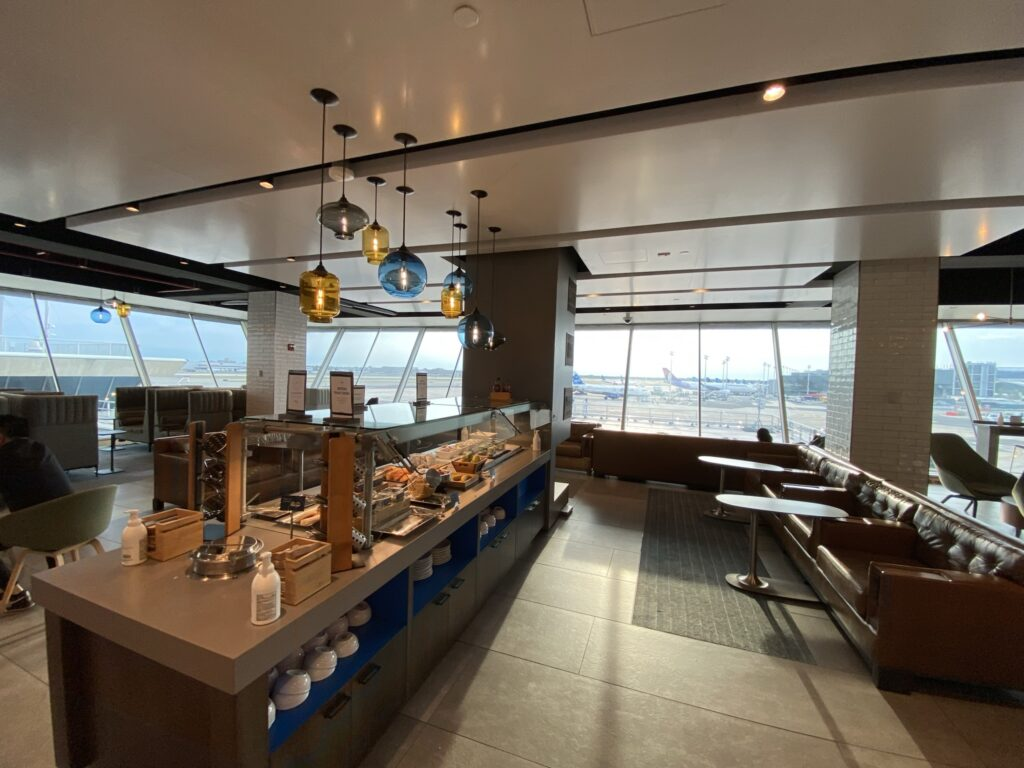 Alaska Airlines' lounge at JFK with a buffet prominent in the center
