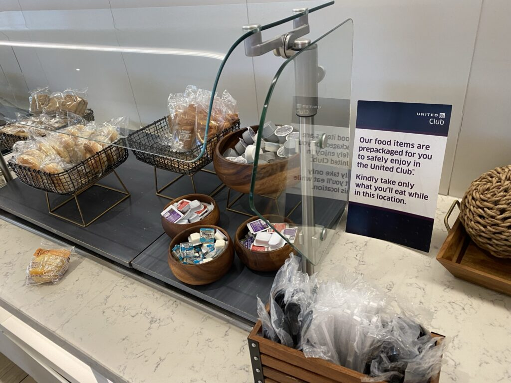United Club breakfast bar with various packaged pastries