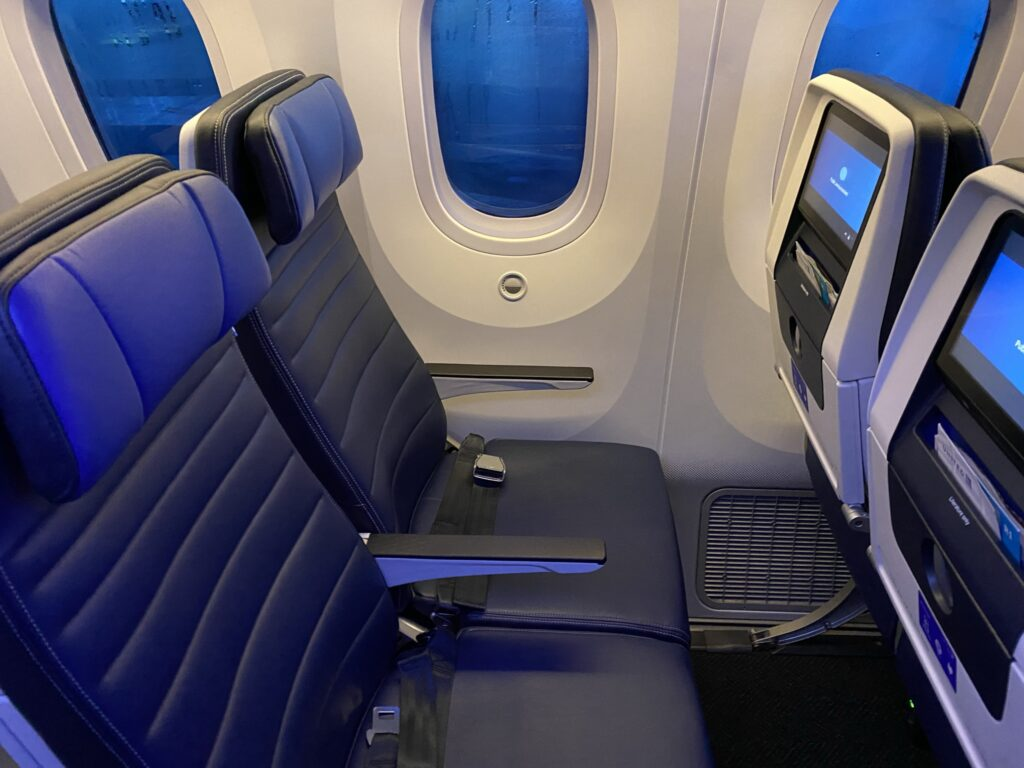 United Airlines' Boeing 787-9 economy class seats, with blue covers, and seatback IFE
