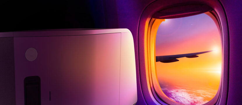 Beautiful scenic view of sunset through the aircraft window. Part of the VUE seat shell is in view, showing that passengers are able to clearly see out the window. A hint of the VUE seat is shown, demonstrating that passengers can clearly see out the window in this outward facing configuration
