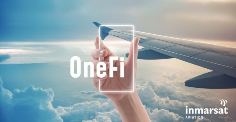An aircraft wing tip in the clouds. A hand is holding up an outline of a mobile device with the Word OneFi overlayed.