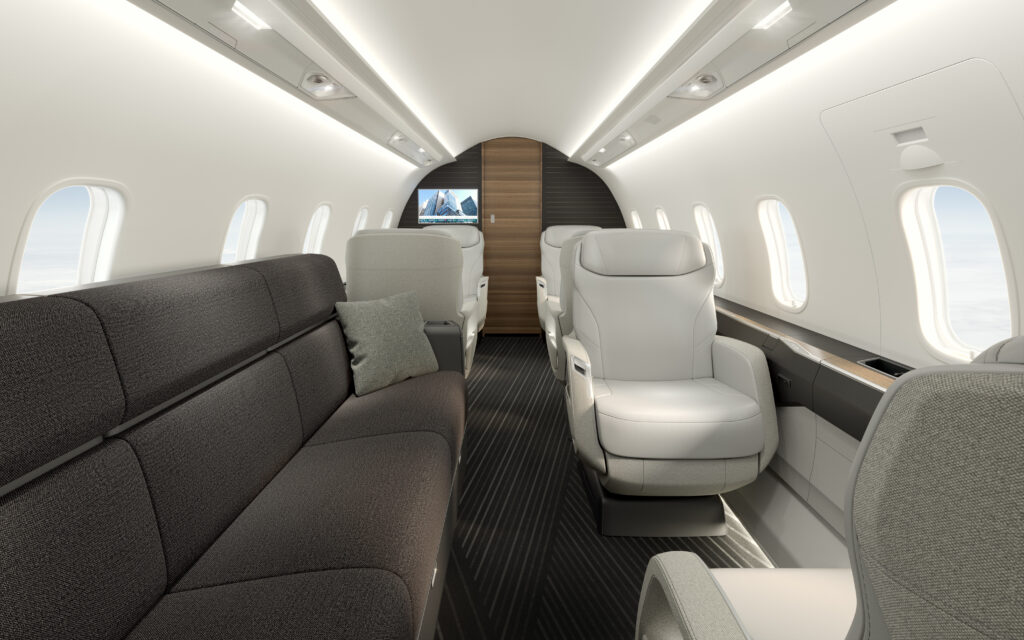 Bombardier Challenger 3500 interior view with a long couch in grey. and some single white seats.