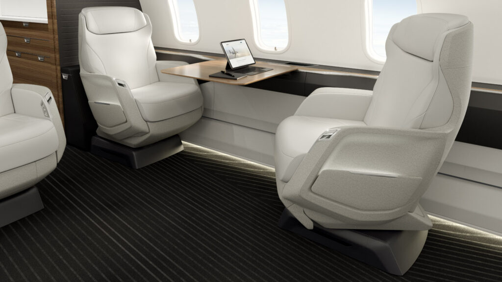 Bombardier Challenger 3500 interior with two seats facing towards each other and a table set up in the middle.