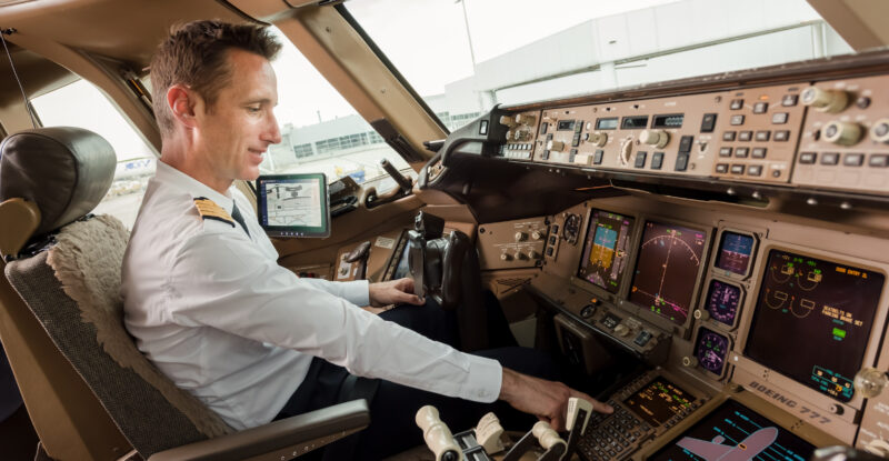Air France captain in the cockpit of an aircraft.