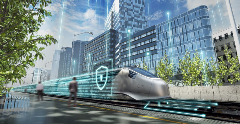 Concept image fo Cyber Security. A city street with a futuristic rail car going through it. A security lock is displayed in the front. Image: Alstom/Design&Styling