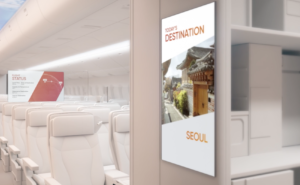 Rendering of AERQ digital signage in the galley entry way as well as on the class divider.