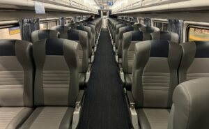 Business Class on the Amtrak train in 2-2 configuration.