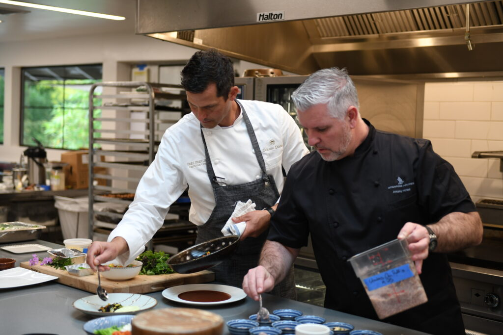 Golden Door Chefs preparing food in a kitchen.