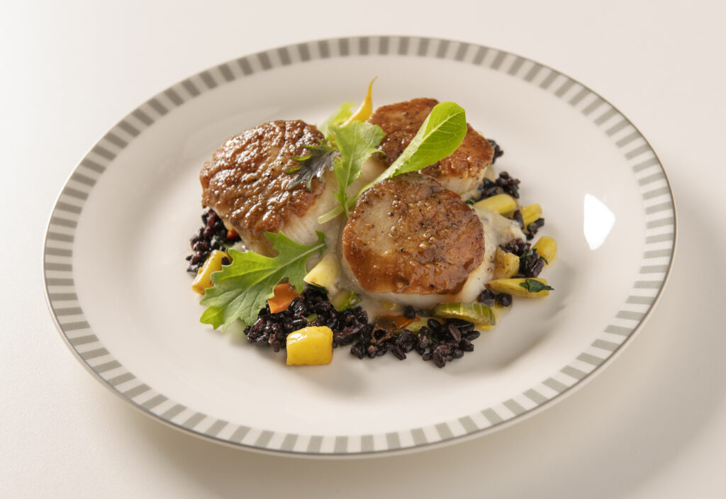 Scallops with cauliflower sauce, wild rice and beurre noisette by SIA and Golden Door.