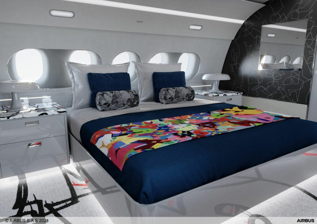 ACJ TwoTwenty bedroom with and brightly coloured bedspread and camouflage pillows
