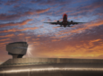 Airplane take off over airport control tower