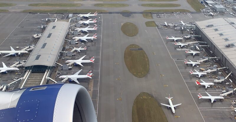 Looking out the aircraft window at Heathrow Airport (UK) while flying overhead
