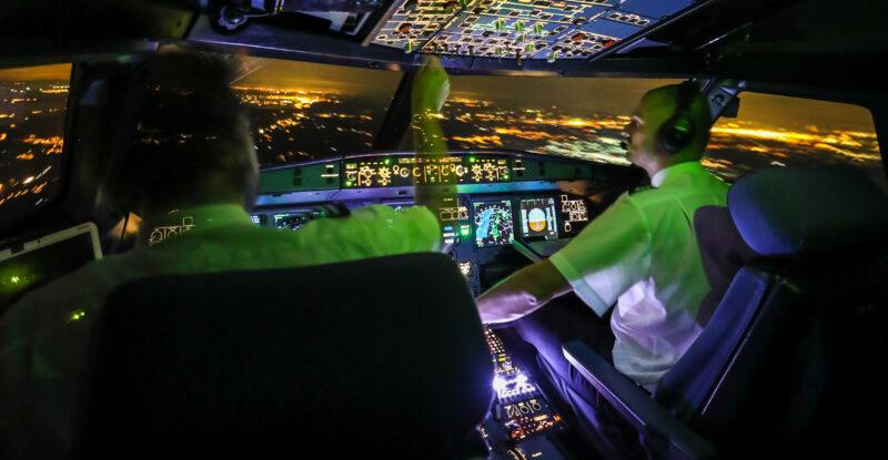 aircraft, pilots, crew, istock, generic, Night Flight A320 with Pilots Left Corner View