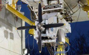 Aricraft engine in a workshop facility.